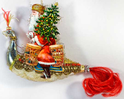 Riding Santa Holding Tree on Silver Bird with Red Feather Tail