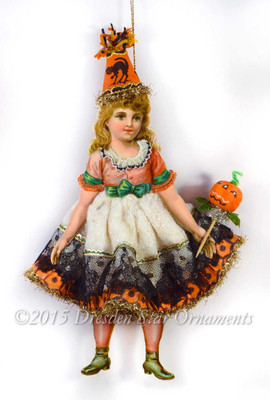 Adorable Girl in Cotton Halloween Costume with Antique Paper and Pumpkin