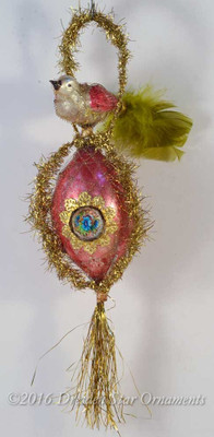 Bird perching on Rare Large Victorian Glass Bead with Gold Tinsel