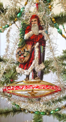 Victorian Santa with Chenille-Lined Cape on Red, Silver, and Gold Christmas Ship.
