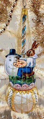 Artist Rabbit Decorating Egg on Antique Pastel Blue Sphere Ornament