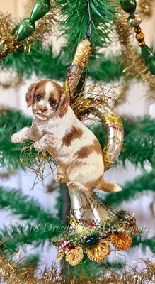 Adorable Spaniel Puppy on Free-Blown French Horn Decorated with Christmas Wreath