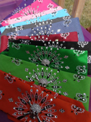 Motorcycle bandana with rhinestone skull and Swarovski crystals. American made bandana, available traditional tie or our unique no tie option as a back closure. Shop on line or swing on by the store in Red Wing, Minnesota