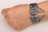 Bracelet, angel wing rhinestone with hinged closure.  Go Brazen has necklaces, rings and earrings to match.