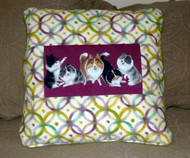 Great accent pillow, purple and green design material.
