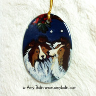 OVAL SHAPED CERAMIC ORNAMENT · UNDER THE MISTLETOE · SABLE SHELTIES · AMY BOLIN