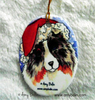 OVAL SHAPED CERAMIC ORNAMENT · SANTA ·  BLUE MERLE SHELTIE · AMY BOLIN