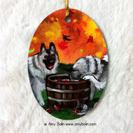 OVAL SHAPED CERAMIC ORNAMENT · BOBBING FOR APPLES · NORWEGIAN ELKHOUND · AMY BOLIN
