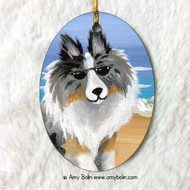 OVAL SHAPED CERAMIC ORNAMENT · HELLO HOLLYWOOD · BLUE MERLE SHELTIE · AMY BOLIN