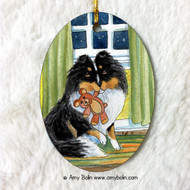 OVAL SHAPED CERAMIC ORNAMENT · BEDTIME BUDDIES · TRI COLOR SHELTIE · AMY BOLIN
