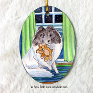 OVAL SHAPED CERAMIC ORNAMENT · BEDTIME BUDDIES · COLOR HEADED WHITE SHELTIE · AMY BOLIN