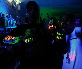 UV Face and Body Paint being used at a Glow Party In a Night Club