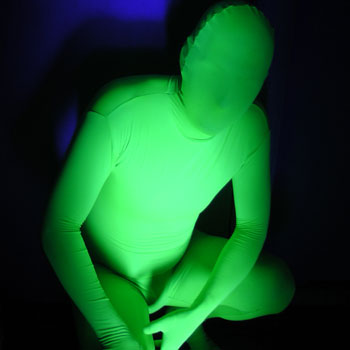 A Black Light Reactive Full Body Suit lights up near Black light