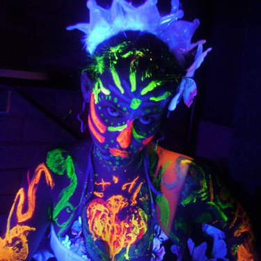 A guest at a UV Paint Party with UV Face Body Paint on her