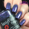 """Drama Queen"" Sassy Pants Polish Debut ""Find Your Sassy!"" Collection (FALL15) Swatched/Reviewed by Polish and Paws: ""Drama Queen is a purple jelly holo featuring holographic pink and teal micro glitter. 2 coats for opacity, a very thin 3rd coat for color intensity. OTD top coat."""