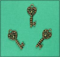 Wrapped around my Heart Key Charm - Antique Brass