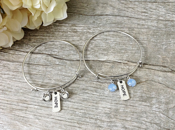 Hope Charm With Two 8.5mm (39ss) Empty Settings On An Expandable Bracelet