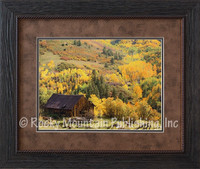 An old barn set in a beautiful western fall landscape