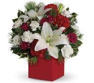 Box arrangement of delightful red roses, white lilies and carnations accented with greenery.  Flowers are subject to seasonal availability. In the event that any of the flowers are unavailable, the florist will substitute with a similar flower in the same shape, style and colour. Stem count, packaging and container may vary.