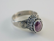 Oval-Cut Ruby and Balinese Scroll Work