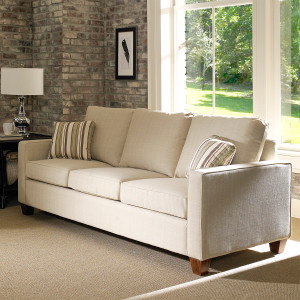The Bridge Street Ottoman comes in your choice of feet, fabric, and finish color.