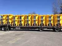DELIVERY OF FISHER POLYCASTER HOPPER SPREADERS