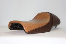 Light brown cover on top and dark brown cover  seat
