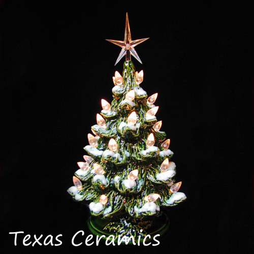 Small ceramic Christmas tree with snow and clear lights made in the USA