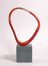 The bronze part has a natural bronze section fand is flanked by a red acrylic painted profile which freely rotates on the Cumbrian slate base. This allows the collector to choose any number of views as the piece is asymmetrical.