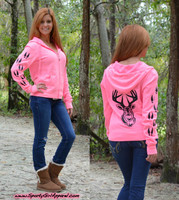 Neon pink zip hoodie with black glitter deer head and tracks
