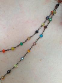 Multicolored semiprecious stones are wrapped in oxidized silver