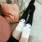 black and white panda socks with fashionista Sabrina Musco