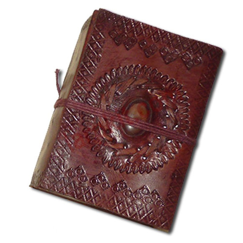 Blank paged, leather-bound book. The cover is made from brown leather with decorative thonging and set with a polished stone. The 60+ inside pages are thick, handmade, cream-coloured paper, with a parchment feel. A useful addition to your kit and perfectly suited to most historical settings.