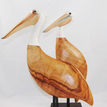Sculpted Wooden Pelicans with Acrylic heads. Great attention to detail. Handmade in Australia.