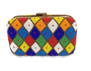 A wardrobe Must have, this Mexican Box clutch will go with most dresses. Featuring Amazing hand beaded pattern of diamonds , it has a long carry chain.