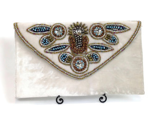The beauty of this one lies in the detail..myriad kinds of beads, sequins, crystals and embroidery weave a magical Beach wedding clutch..