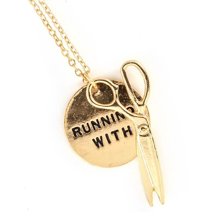 golden 'running with scissors' necklace