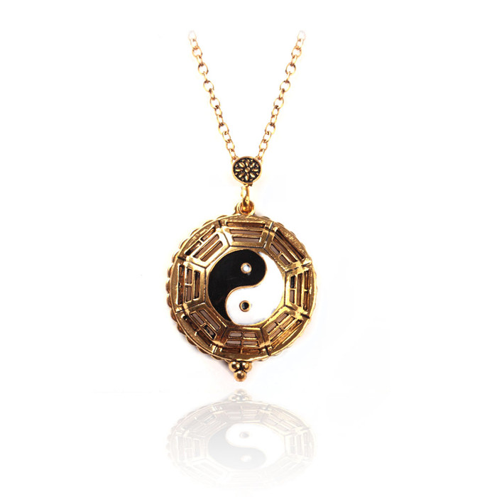 black and white enameled yin-yang/tao golden necklace with magnifying glass