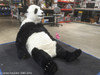 Panda costume in a relaxing pose