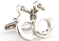 silver handcuff cufflinks close up image