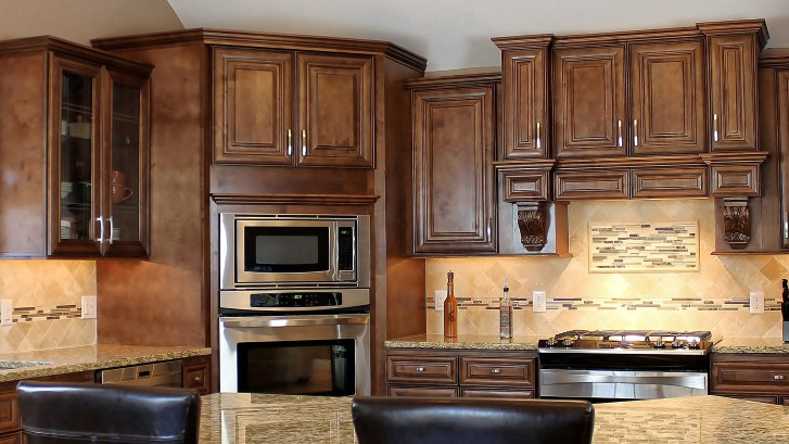 Need Cabinets? Shop J&K Chocolate Maple Glaze Cabinets