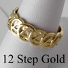 Style #522-7, 14k Gold,Ring with Continuous AA Symbol Circle Triangle Band