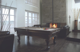 The Banff pool table has a blend of both traditional and modern flare. This billiard table comes with ball and claw legs and a sleek modern body make it a versatile model.  Premium framed slate extends underneath the rails for consistent play.  This pool table is available in 3 finishes:  Midnight Stroll, Chocolate Pear Tree, and Passion as well as 2 sizes:  4'x8' and 41/2'x9'.