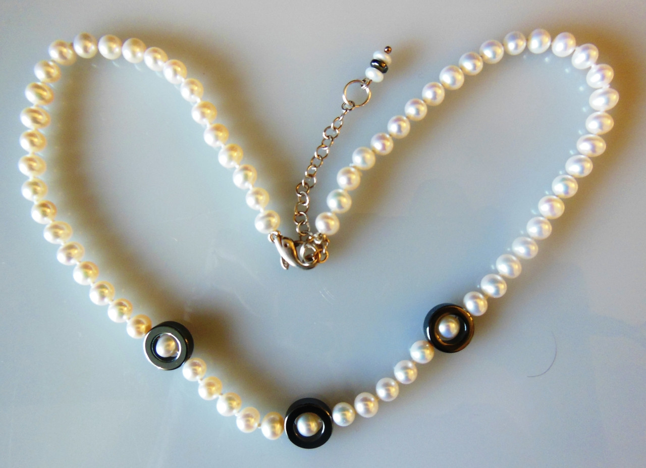 Hematite Circles on white pearls