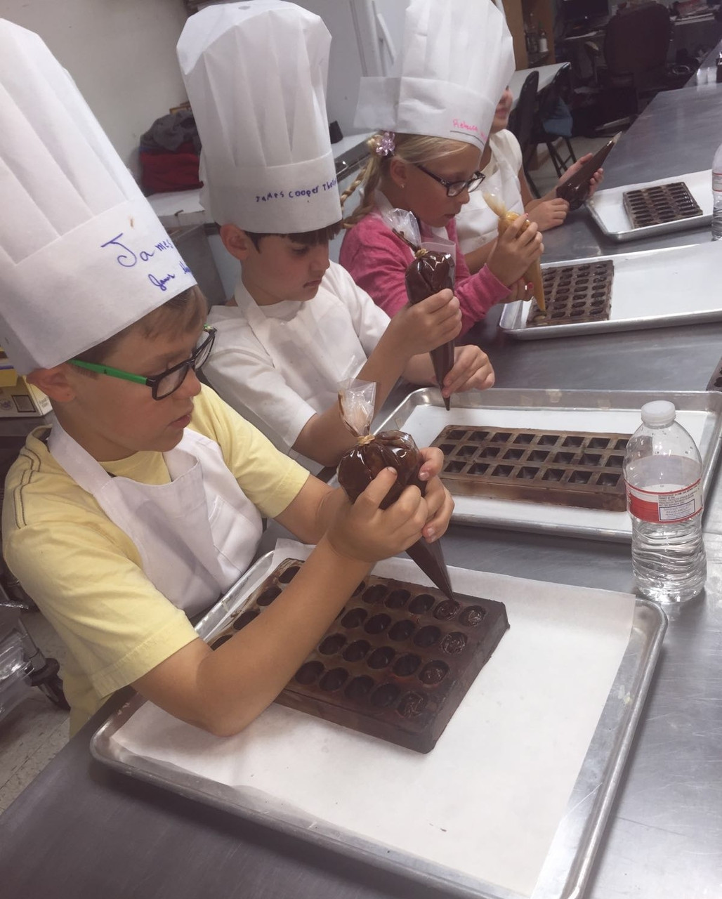 Filling the molds with the chocolate ganache.