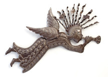 trumpeting Metal angel made of recycled metal in haiti
