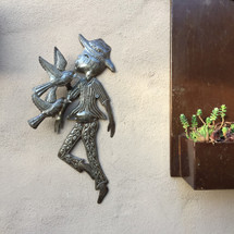 Boy with Birds , folk art sculpture from Haiti Metal art