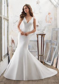 Mori Lee 5506.  The Perfect Combination of Simple and Chic, This Larissa Satin Fit & Flare Wedding Dress Features Stunning Crystallized Back Detail. Covered Buttons Trim the Back and Train. Colors Available: White/Silver, Ivory/Silver. Shown in Ivory/Silver.