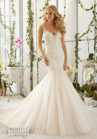 Mori Lee 2823.  Tulle mermaid gown with intricate crystal beaded embroidery.  Available in white/silver, ivory/silver, and light gold/silver.