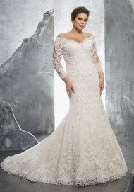"Mori Lee 3231.  Classic Long Sleeve Wedding Gown Featuring Crystallized Alenon Lace Appliqus and Medallions on Net. An Off-the-Shoulder Neckline and Scalloped Hemline Complete the Look. Available in Three Lengths: 55"", 58"", 61"". Colors Available: White, Ivory, Ivory/Coco."